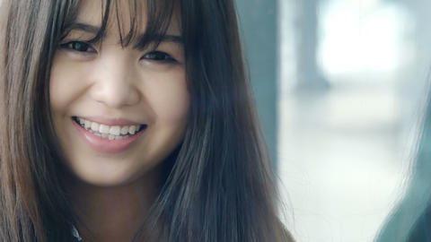 smiling attractive young chinese woman with shallow depth of field Footage
