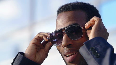 African american black businessman wearing sunglasses: successful businessman Live Action