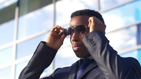 handsome businessman with sunglasses Live Action