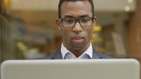 young black businessman using laptop: working out the office Footage