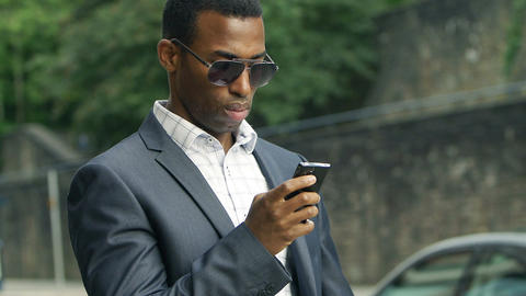 black american/african businessman using mobile phone to send message of email Footage
