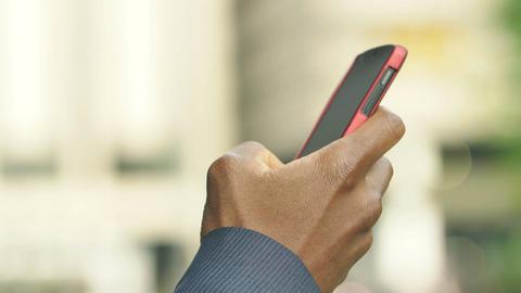 black american hand using smartphone: closeup footage on black man hand Footage