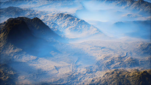 Distant mountain range and thin layer of fog on the valleys GIF