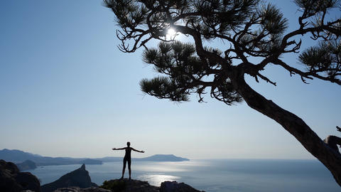 Female tourist athlete climbed to the top of high Mountain in Crimea. Young 실사 촬영