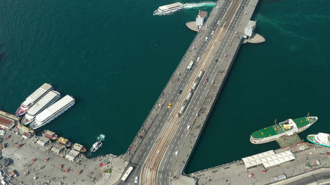 Public transportation Tram Train passing Galata Bridge over Bosphorus in Live Action