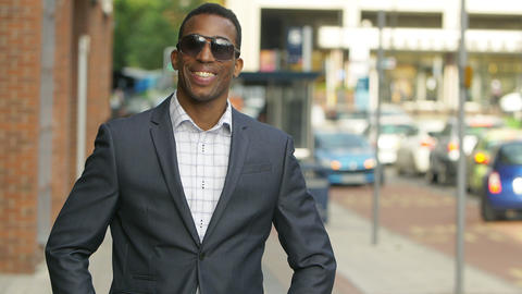 handsome elegant and confident black businessman in the city Footage