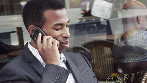 handsome black businessman working with the smartphone out his office Footage