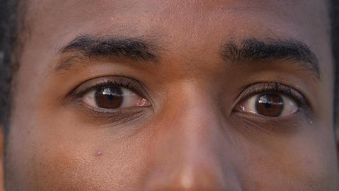 black man eyes: African-American man opens his eyes Footage