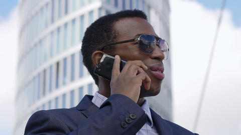 Young Handsome Businessman Talking On Mobile Phone In The City Footage