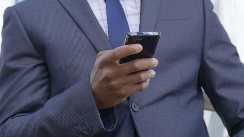 Businessman Using Mobile Phone: African american businessman sending email Footage