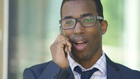 handsome black businessman at the phone Live Action
