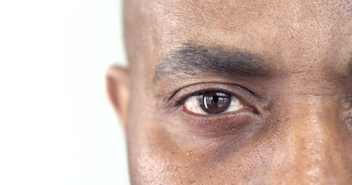 Extreme Close-Up of a Brown Eye of an Afro-American Man Footage