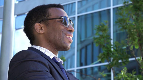 Young African American businessman posing smiling and satisfied: success at work Footage
