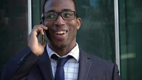 young black businessman he is smiling and relaxed talking about business Footage