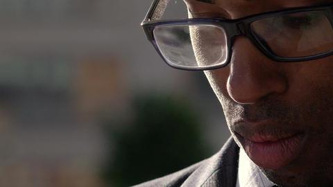 handsome businessman closeup portrait: american african businessman Live Action