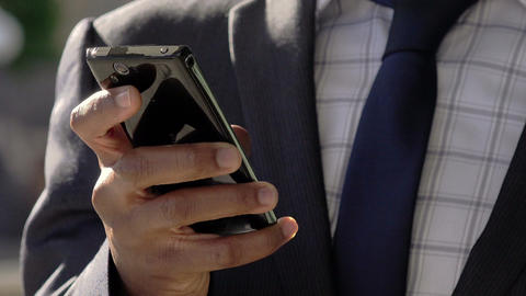 elegant businessman using smartphone to send messages or email: cell phone Footage