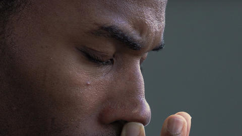 closeup side footage of depressed and worried black businessman: afro-american Footage