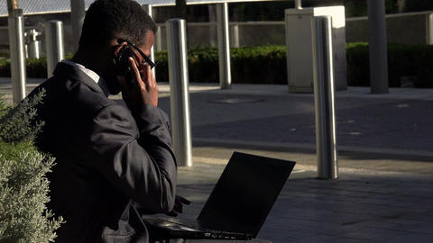 black businessman working with laptop and smartphone Footage