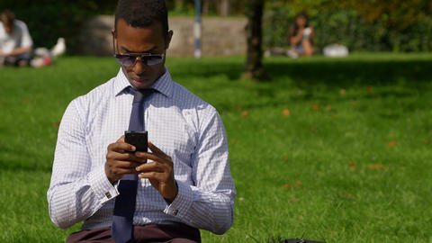 Businessman sending messages or Email with a mobile phone: smartphone Footage