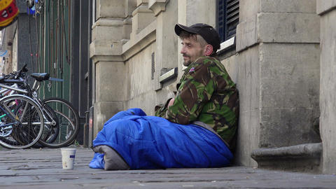 young outcast homeless begging in the street among the passers Footage