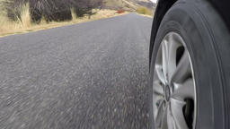 Driving car POV front wheel rural mountain road HD 952 Footage