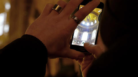 tourist in the mosque of santa sofia takes a picture with his mobile Footage