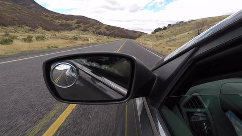 Driving POV rear view mirror mountain valley fast HD 947 Stock Video Footage