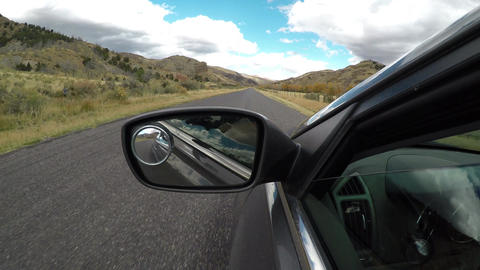 Driving view from side of car mirror mountain valley POV 4K 951 Footage