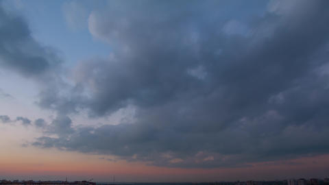 Evening Clouds over the City. Time Lapse Footage