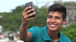 Good Looking Teen Boy Taking Selfy And Smiling Live Action