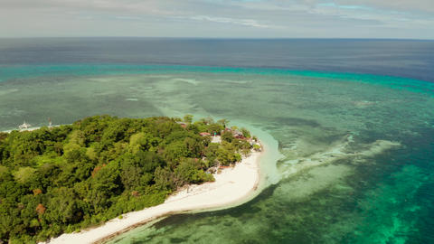 Tropical island with sandy beach. Mantigue Island, Philippines Live Action