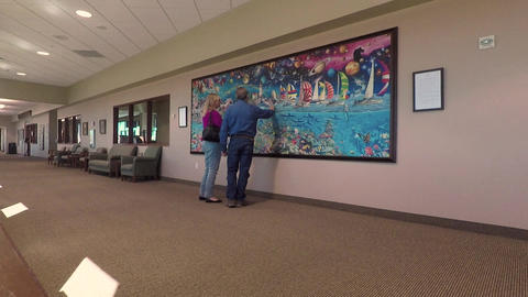 Hospital husband wife view puzzle art on wall HD 893 Footage