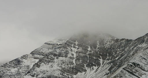 Majestic mountain peak swirling clouds winter storm DCI 4K 795 Footage