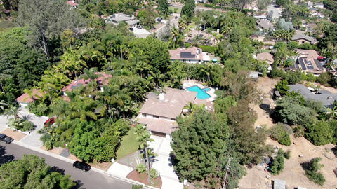 Aerial view of big rich residential villas with swimming pool Live Action