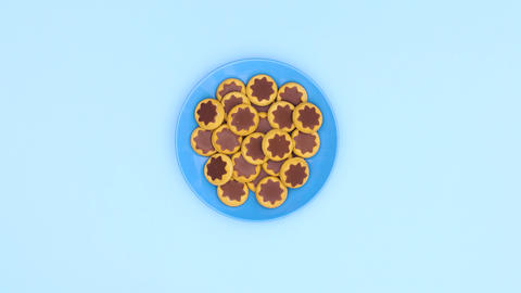 Blue plate with cookies appear on blue theme. Stop motion Animation