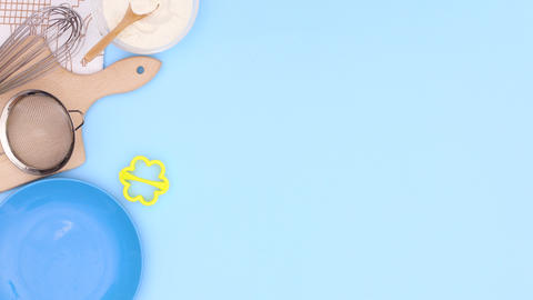 Cookies in blue plate and ingredients for baking appear with frame for recipe on blue theme. Stop Animation
