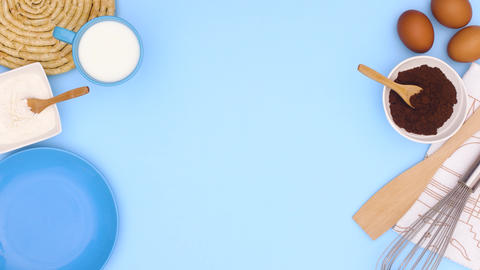 Cookies in blue plate and ingredients for baking appear on blue theme. Stop motion Animation