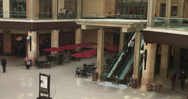 Modern mall escalator to second floor stores DCI 4K 773 Footage
