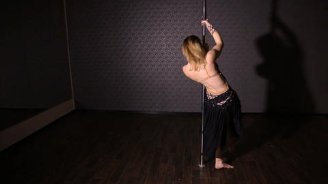 Girl in black dress dancing pole dance Footage