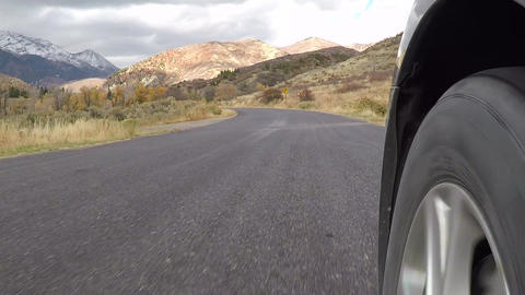 POV front wheel car tire mountain road slow HD 957 Footage