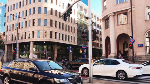 Cars on the street, traffic in the city downtown, modern architecture and Live Action