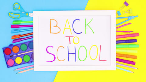 Frame with back to school text with school stationery on blue yellow theme. Stop motion Animation