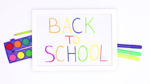Back to school title inside of frame with school stationery. Stop motion Animation