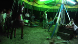 Children Fly Around A Manuel Carousel At Night In Myanmar stock footage