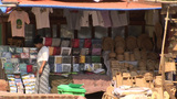 A Woman Sells Clothing And Wooden Products At An Outdoor Market Near Buddhist Temples In Pagan Of Bu stock footage