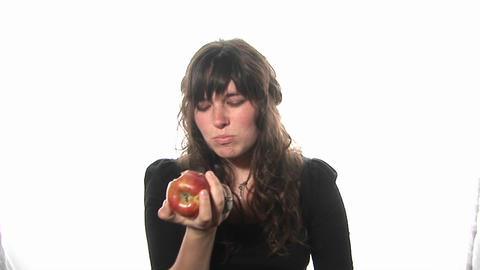A woman eats an apple Footage