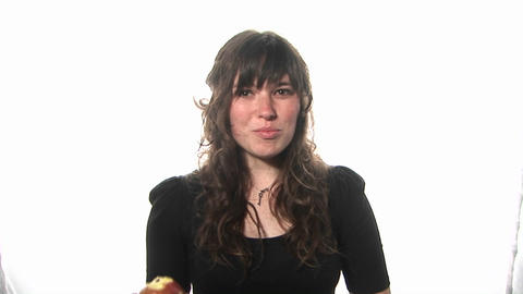 A woman eats an apple Stock Video Footage