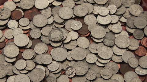 A pile of change sits on a table Footage