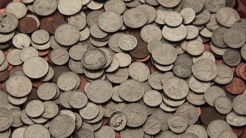 A pile of change sits on a table Stock Video Footage