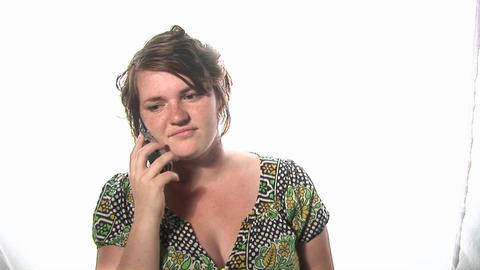 A happy young woman dances and talks on a cell phone Stock Video Footage